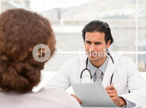 Charismatic doctor during an appointment with a female patient