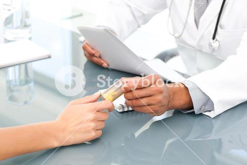 Close up of a doctor giving drugs to his patient during an appointment