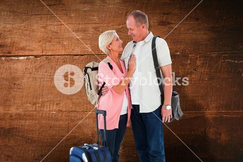 Composite image of smiling older couple going on their holidays