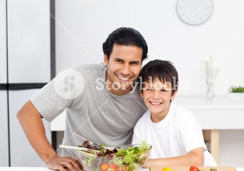 Portrait of a cute boy with his father in the kitchen
