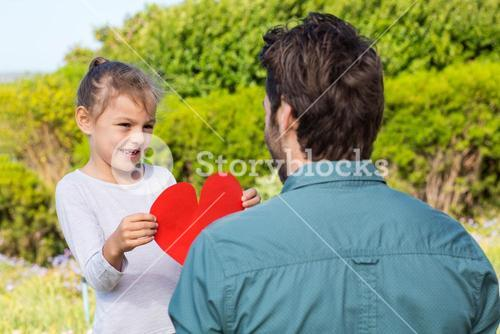 Daughter giving dad a heart card