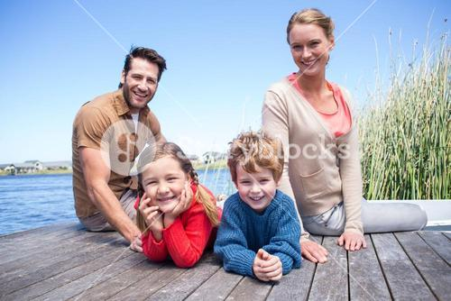Happy family at a lake