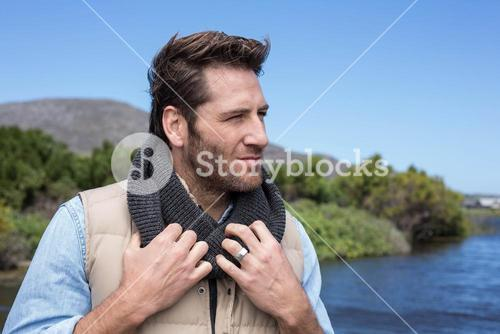 Handsome casual man at a lake