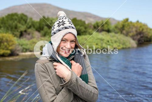 Happy casual woman at a lake