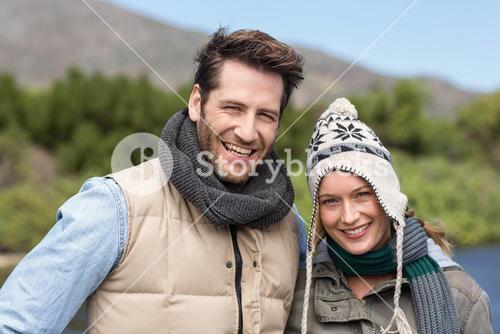 Happy casual couple at a lake