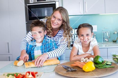 Happy family preparing lunch together