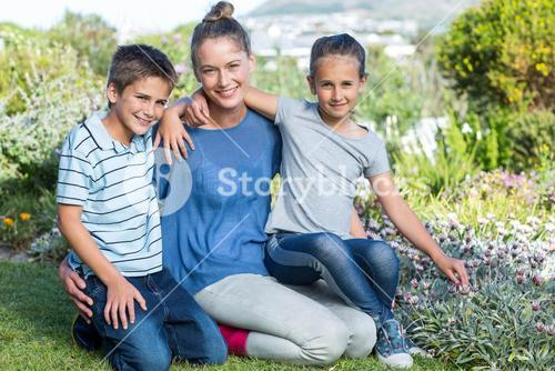 Mother and children tending to flowers