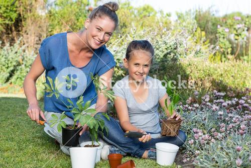 Mother and daughter tending to flowers