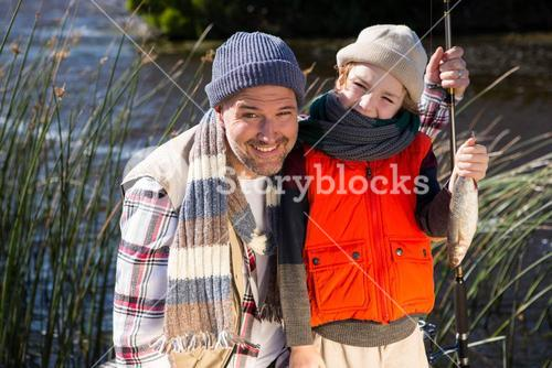 Happy man fishing with his son