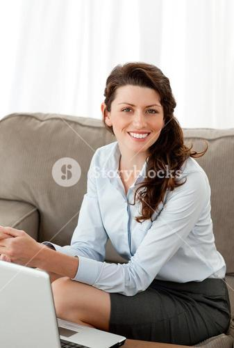Happy businesswoman working at home