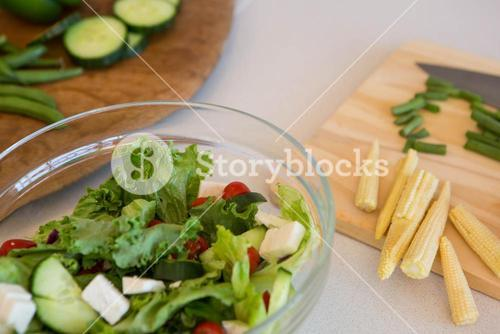 Salad and vegetables on table