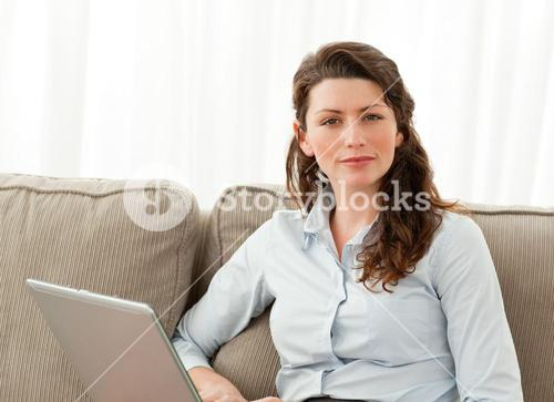 Charismatic businesswoman working in the living room
