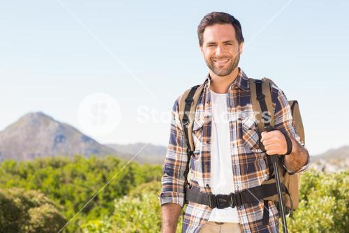 Happy man hiking in the mountains