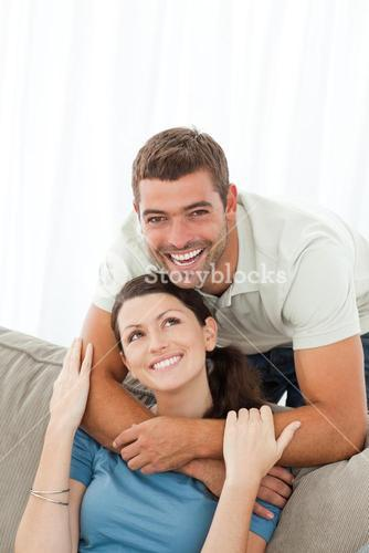 Portrait of an affectionate man with his girlfriend in the livingroom