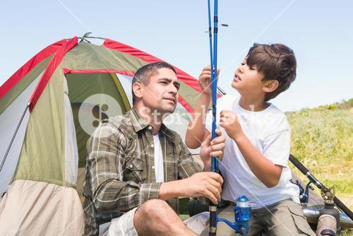 Father and son by their tent