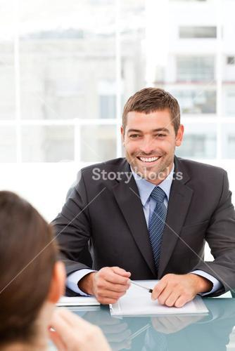 Cheerful businessman during a meeting with a collegue