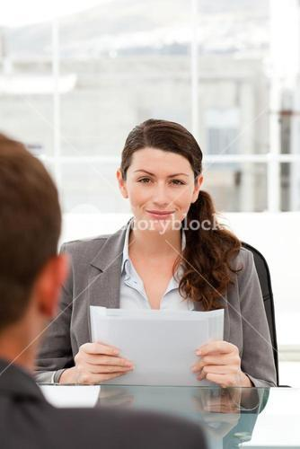 Charismatic businesswoman during an interview with a businessman