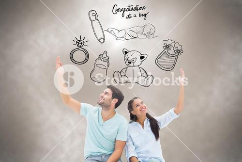 Composite image of cute couple sitting with arms raised