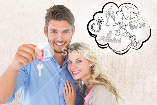 Composite image of attractive young couple showing new house key