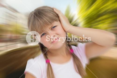 Composite image of little girl with headache