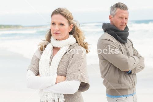 Upset couple look away from each other