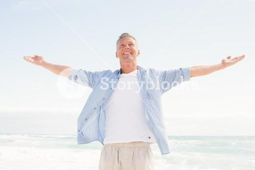 Handsome man with arms outstretched