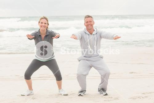 Fit couple smiling at camera