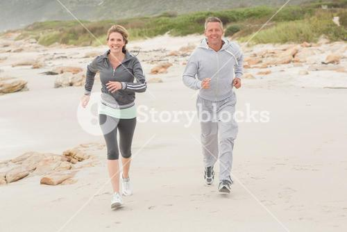 Fit couple jogging to camera