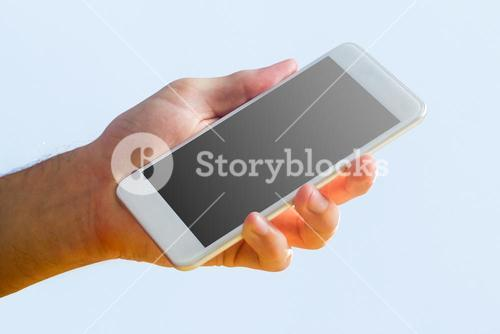 Hand holding a white smartphone