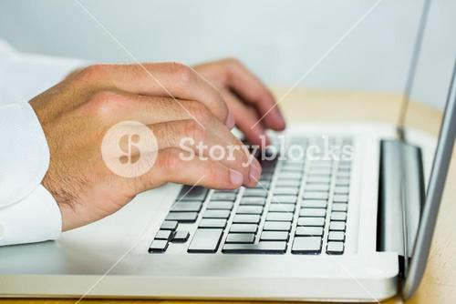 Man using laptop on desk