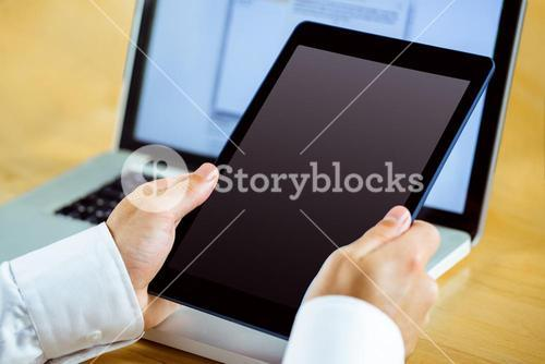 Man using laptop and tablet