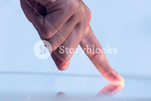 Man pointing on reflective surface