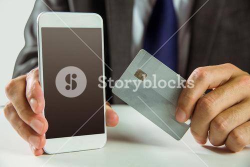 Businessman using smartphone for online shopping