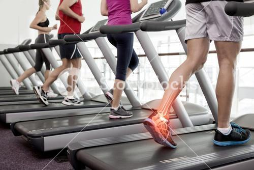 Highlighted ankle of man on treadmill