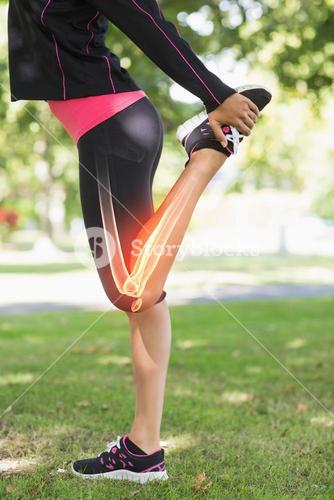 Highlighted leg of stretching woman