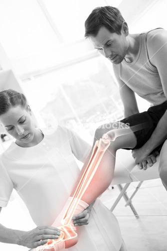 Highlighted knee of injured man at physiotherapist