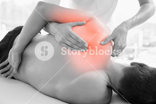 Highlighted shoulder of man at physiotherapy