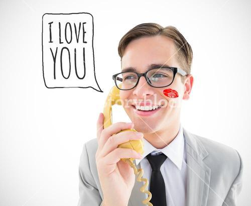 Composite image of geeky businessman talking on retro phone