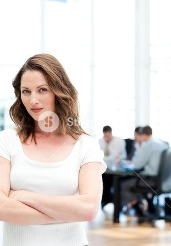 Confident woman standing at a meeting