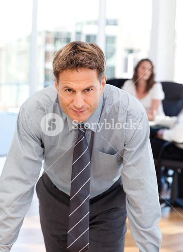 Confident man posing in front of his colleague during a meeting