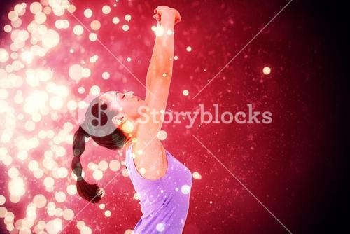 Composite image of fit brunette stretching her arms