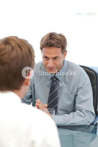 Charismatic manager during an interview with an employee