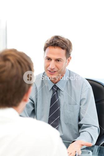 Serious manager talking with an employee during an interview