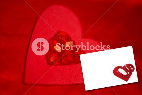Composite image of rubies and paper red heart