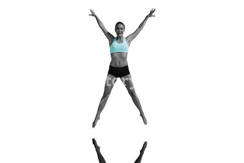 Composite image of fit woman jumping with arms out