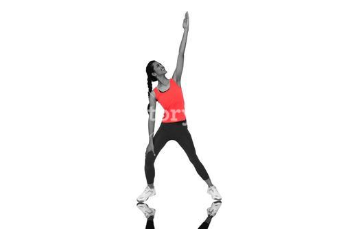 Composite image of full length of a sporty young woman stretching hand