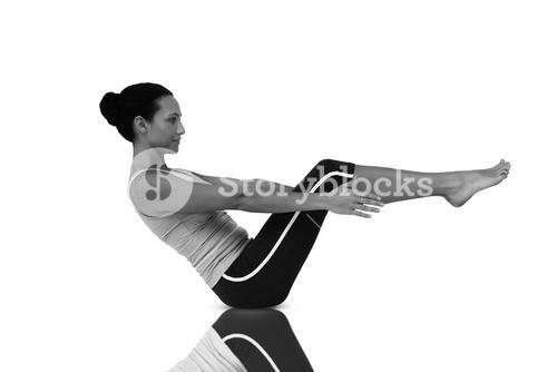 Composite image of side view of a fit young woman doing the boat pose