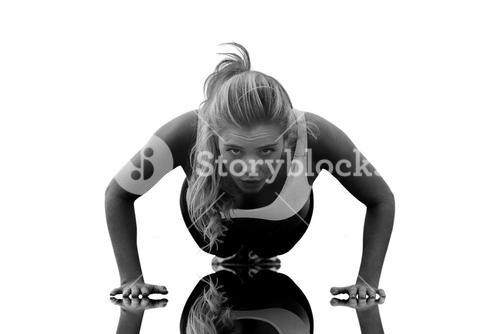 Composite image of beautiful woman doing push ups on beach