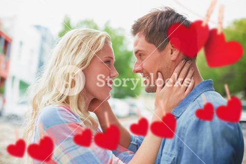 Composite image of hip young couple smiling at each other