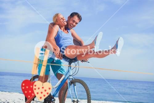 Composite image of happy man giving girlfriend a lift on his crossbar